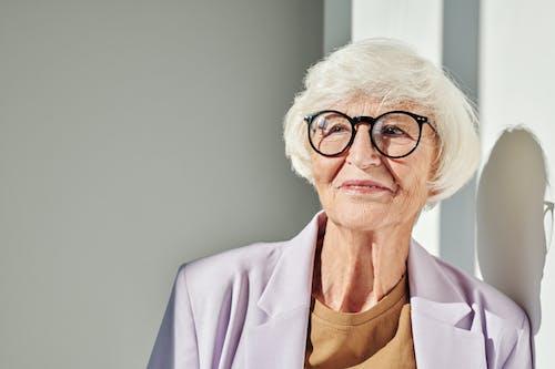 Elderly Woman in Lavender Blazer Wearing Black Eyeglasses