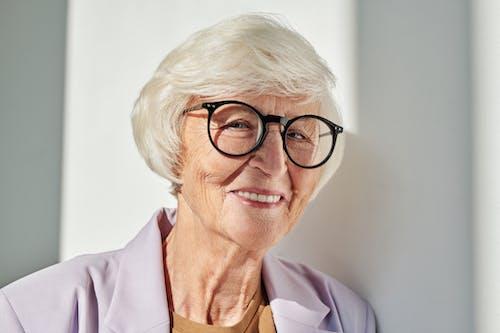 Elderly Woman Wearing Black Eyeglasses Looking at The Camera