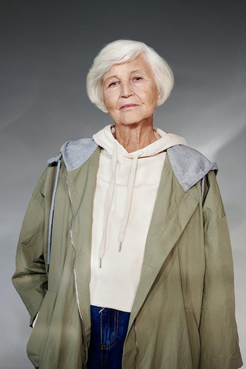 Woman Wearing a Green Jacket Looking at The Camera