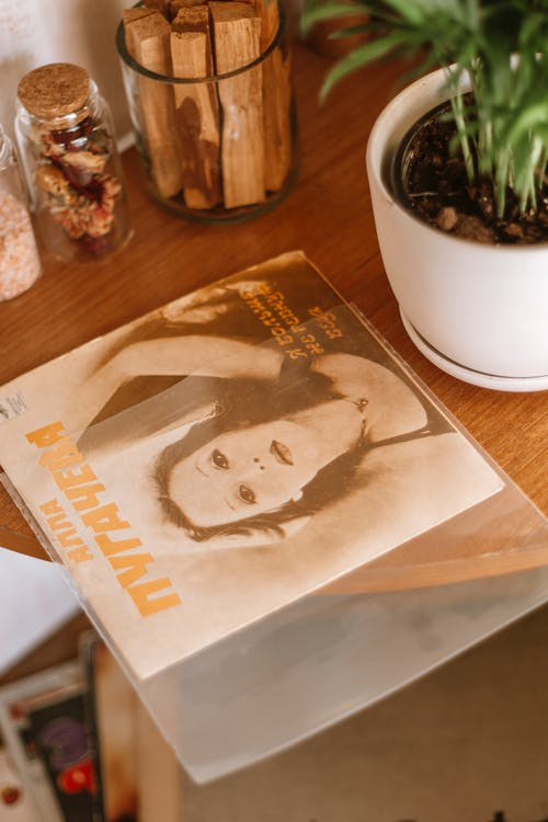Vinyl record with image and inscription on table