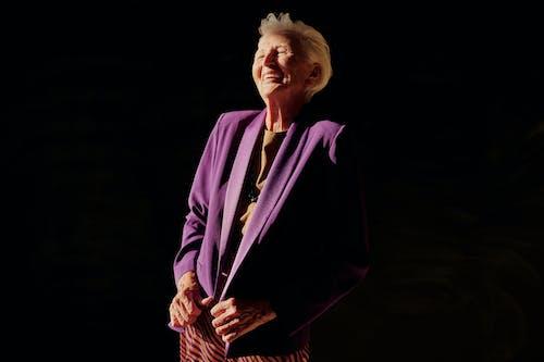Woman in Purple Blazer Standing