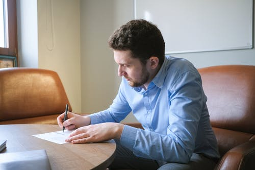 Businessman working on project sitting at office desk