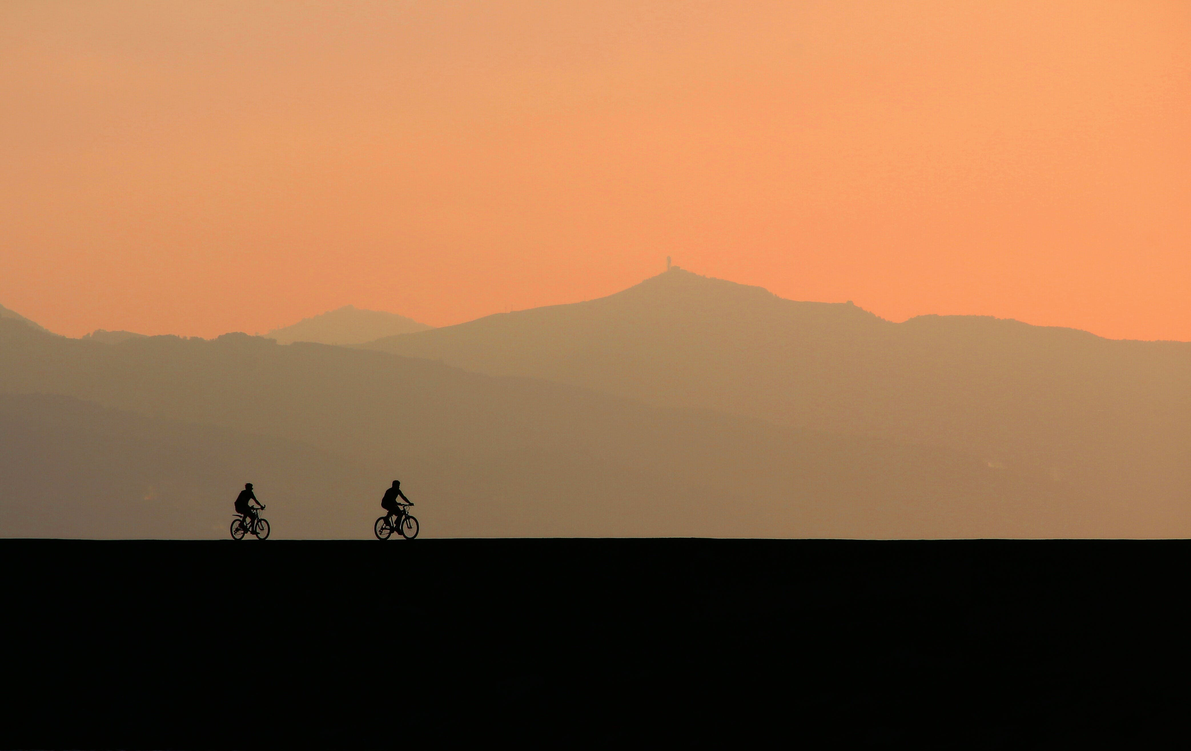 Silhouette Photo of Two Cyclists