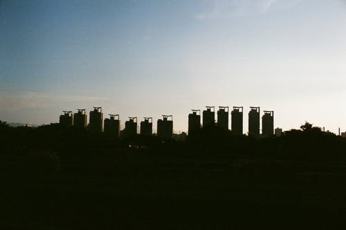 High rise buildings in town in evening