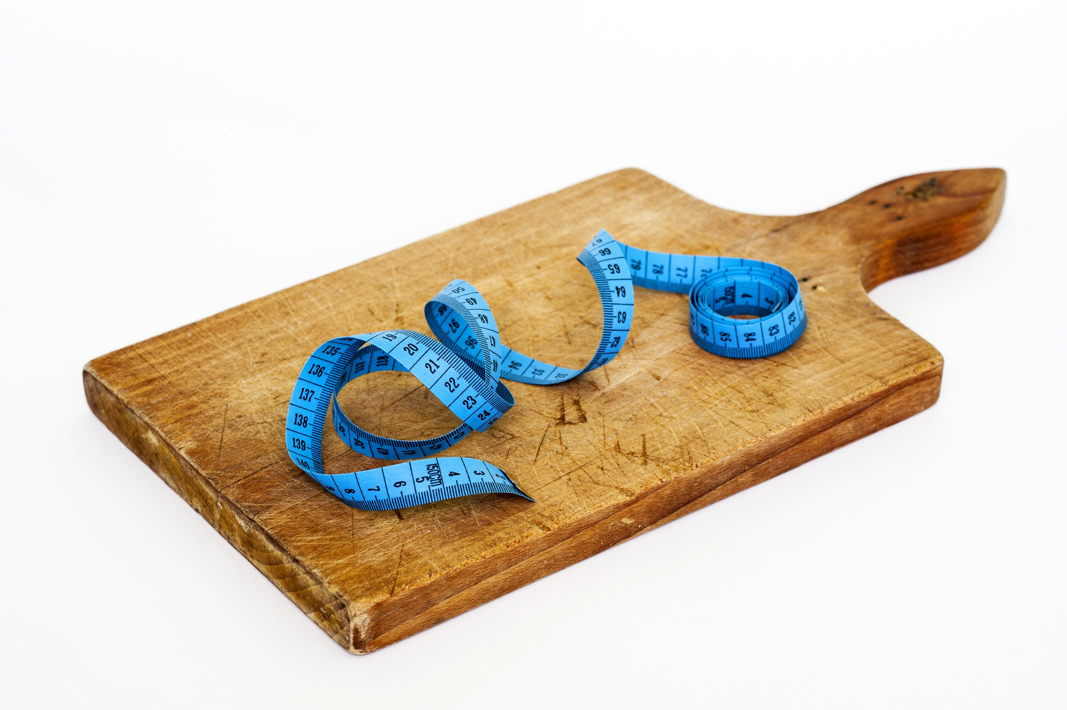 Blue Measuring Tape on Brown Wooden Chopping Board