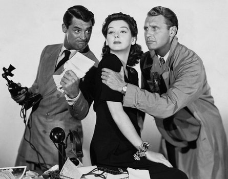 Greyscale Photo of Woman Between Two Man