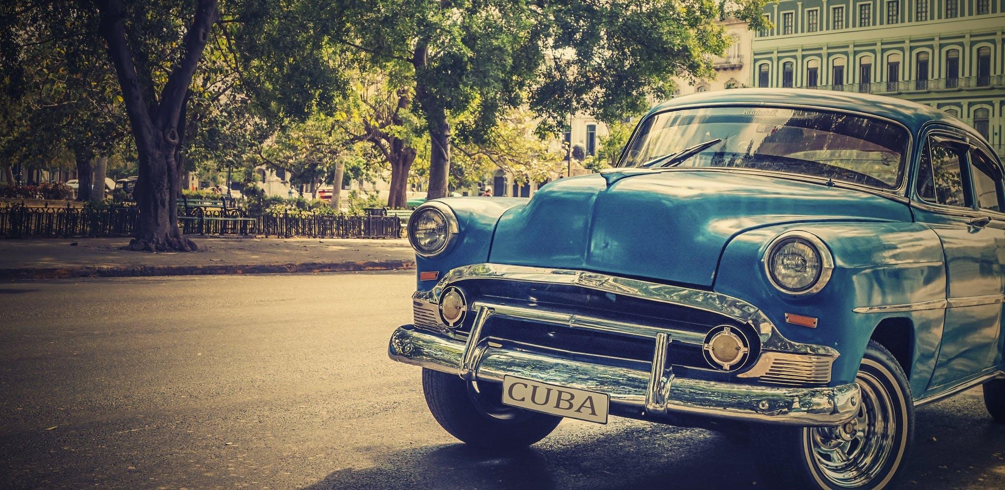 Vintage Blue Car on Roadside