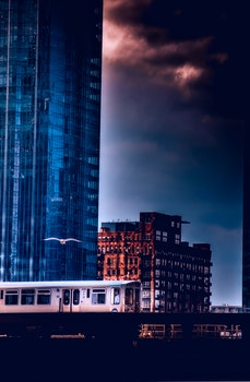 Free stock photo of sunset, buildings, train, architecture