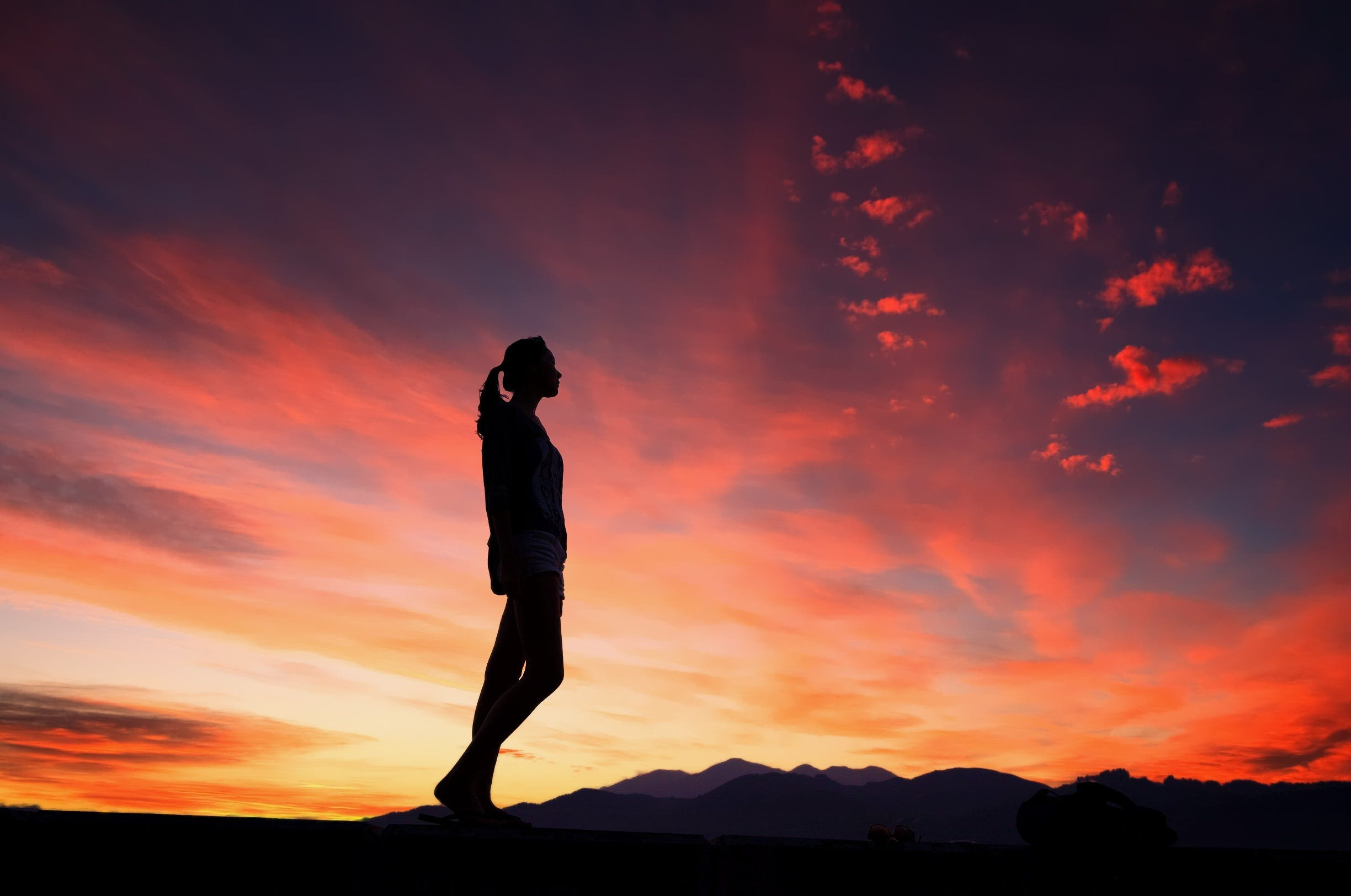 Silhouette of Woman during Orange Sunset