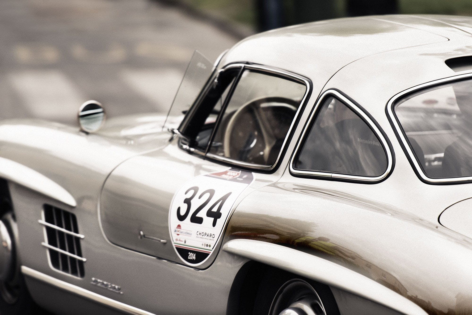 White and Gray Vintage Sports Car