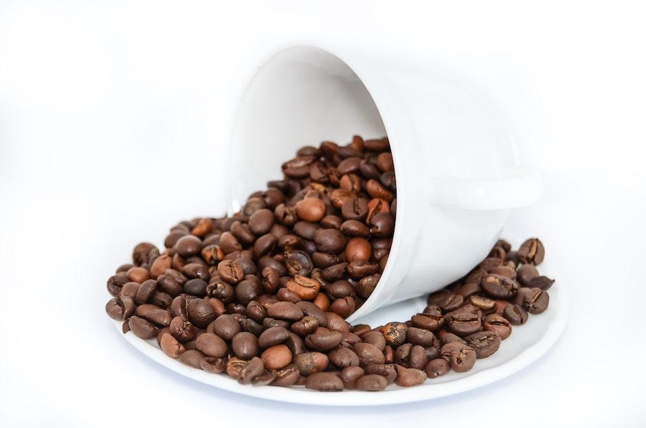 Coffee Beans on White Ceramic Mug and Plate