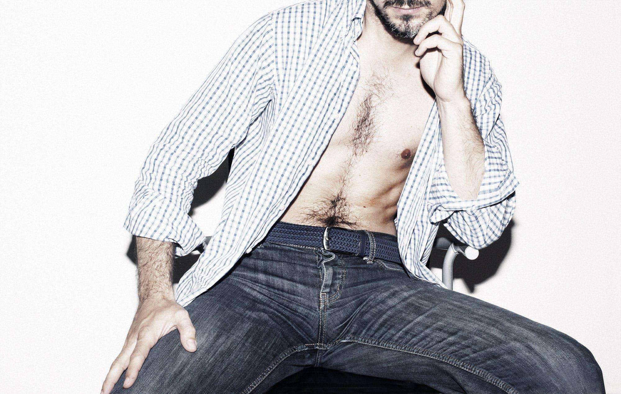 Man in Black White Gingham Dress Shirt and Blue Denim Jeans