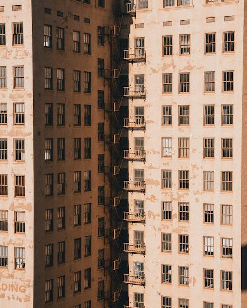 Old geometric residential buildings on city street