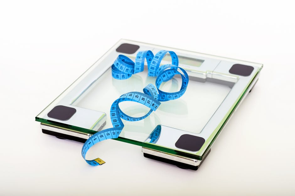 Blue Tape Measuring on Clear Glass Square Weighing Scale