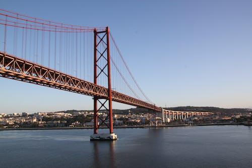 Безкоштовне стокове фото на тему «25 de abril міст, архітектура, будівлі, будівництво»
