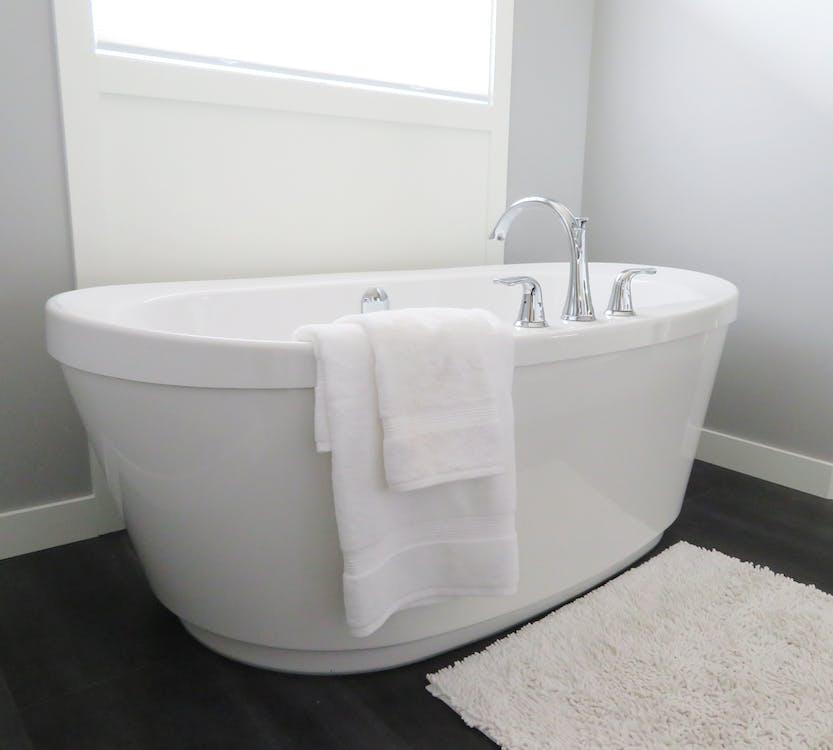 White Ceramic Bathtub Near Window