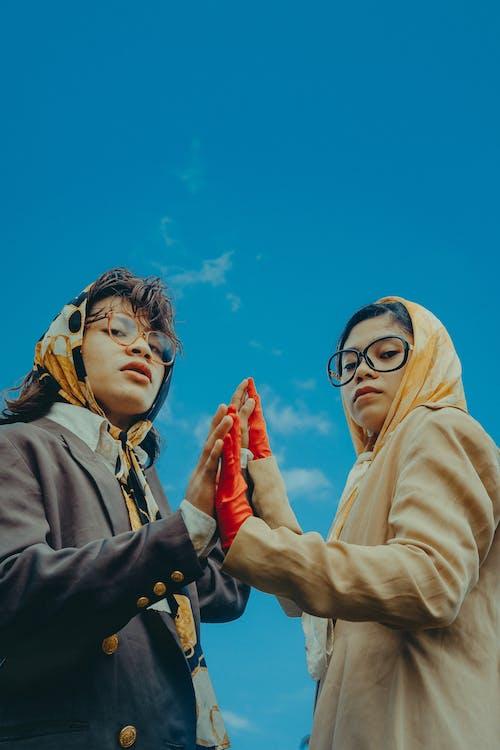 2 Women in Hijab and Eyeglasses Under Blue Sky