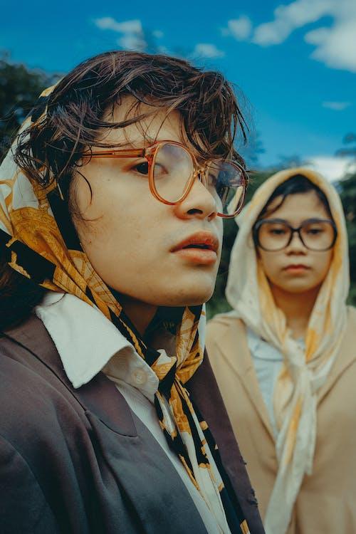 Woman in Brown Jacket Wearing Brown Framed Eyeglasses