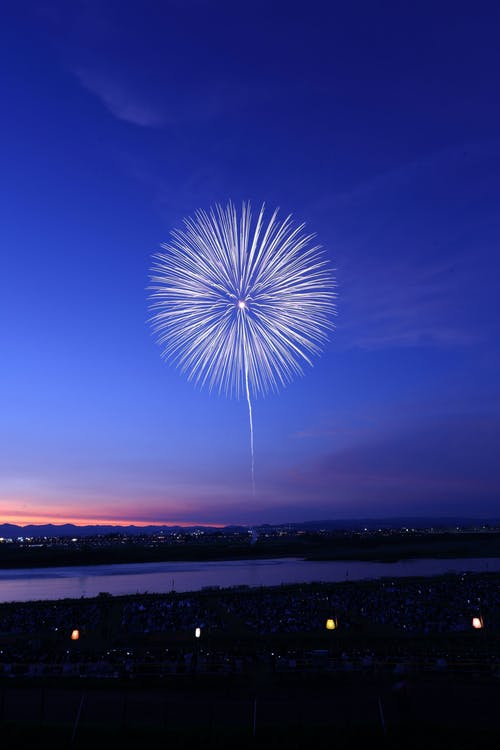 White Fireworks on Blue Sky during Night Time