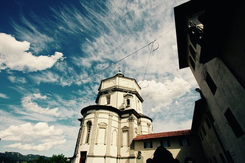 White Commercial Building Under Blue Sky