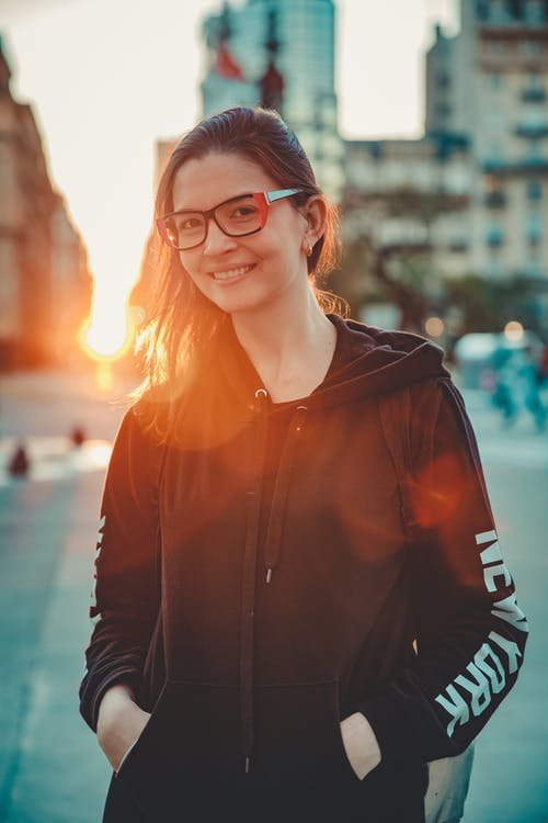 Woman in Black Leather Jacket Wearing Black Framed Eyeglasses