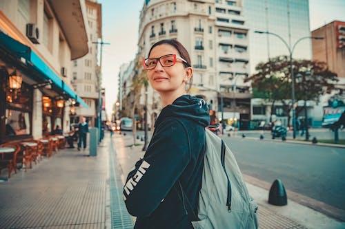 Man in Black Jacket Wearing Black Framed Eyeglasses Standing on Sidewalk