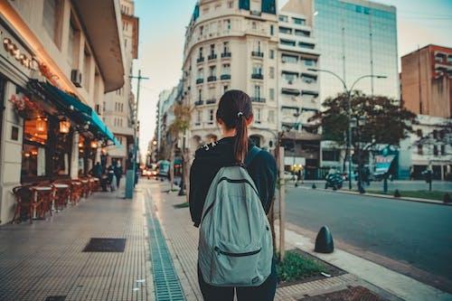 Woman in Gray Hoodie Standing on Sidewalk