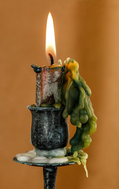 Lighted Candle on Black Steel Holder