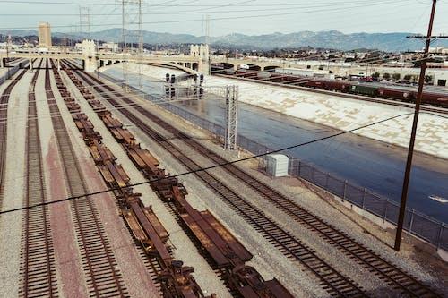 Photography of Train Rails Under Bridge