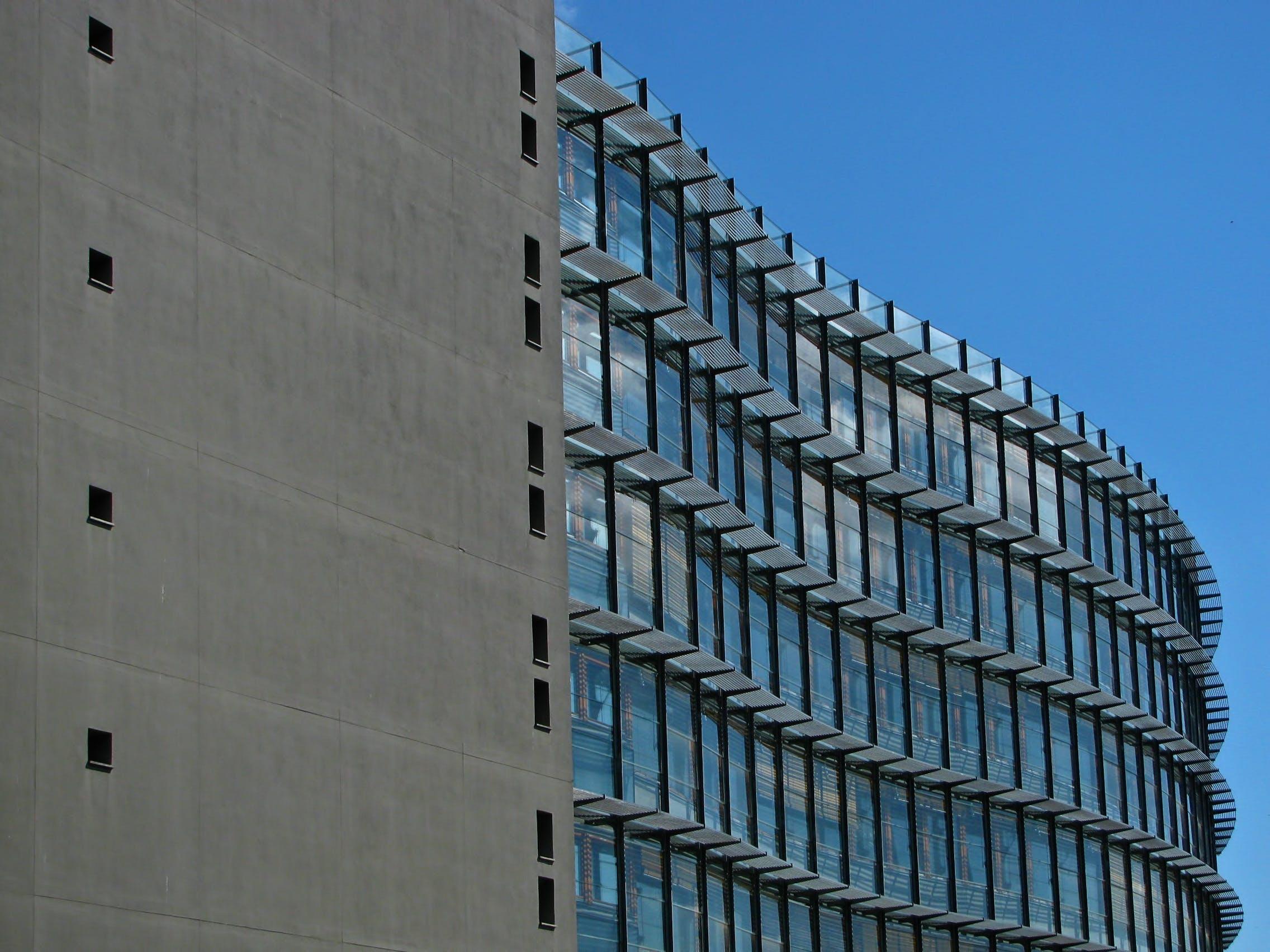 Grey Concrete Building With Blue Windows