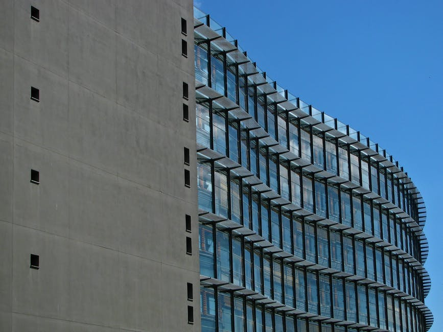 Concrete Building With Windows : Grey concrete building with blue windows · free stock photo