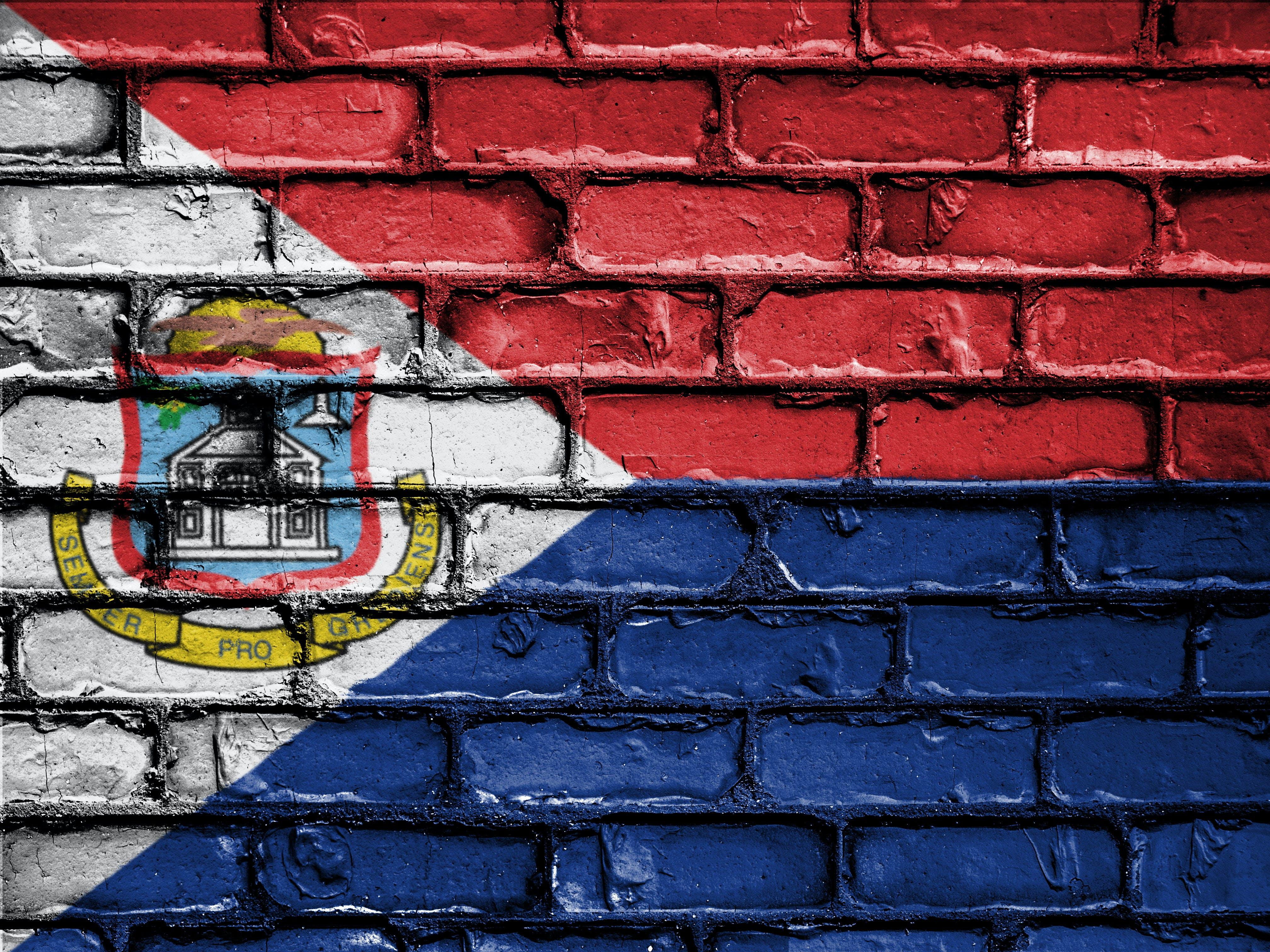 Free stock photo of banner, bricks, wall, flag