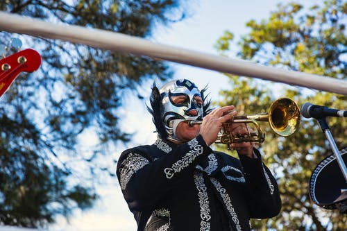 Free stock photo of facemask, trumpet player