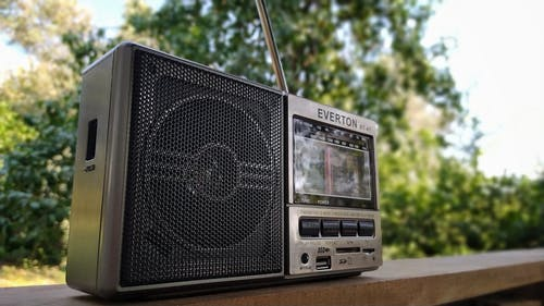 Black and Silver Radio on Brown Wooden Table