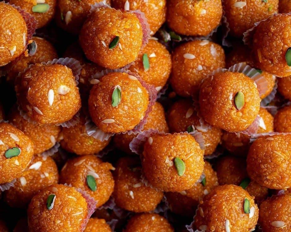 Close Up Photo of Orange Donuts