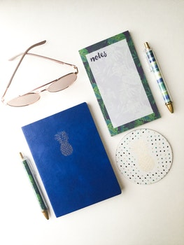 Free stock photo of sunglasses, blue, notes, pens