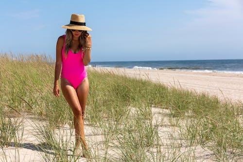 Woman enjoying summer day on beach