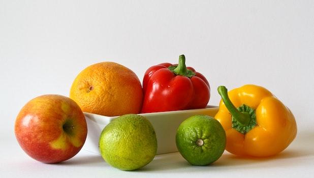 Red Apple Fruit Near Red Bell Pepper