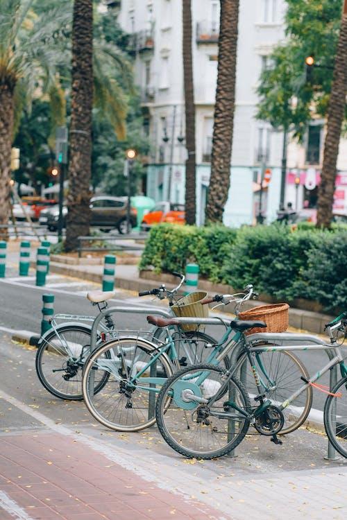 Black City Bike Parked on Sidewalk