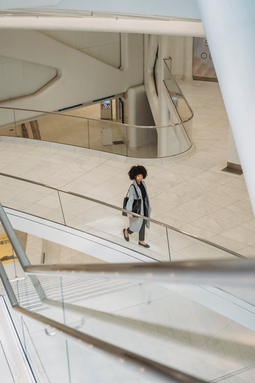 Ethnic woman walking in modern building