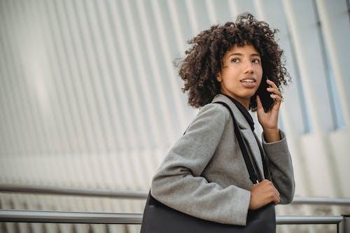 Black woman having phone call in mall