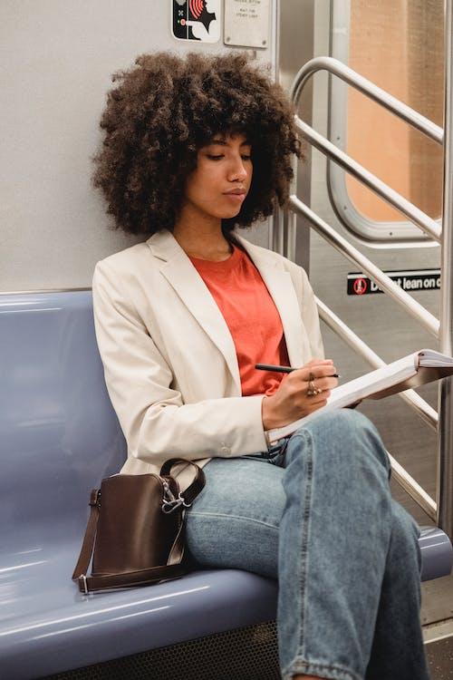 A Woman in a White Blazer Writing