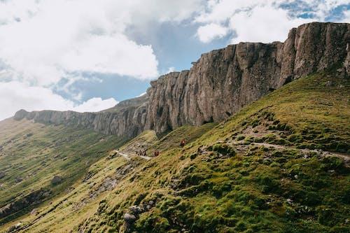 People Hiking a Mountain