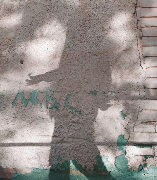 Shadow of a Person over the Concrete Wall