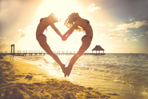 Two Woman Forming Heart at the Shore