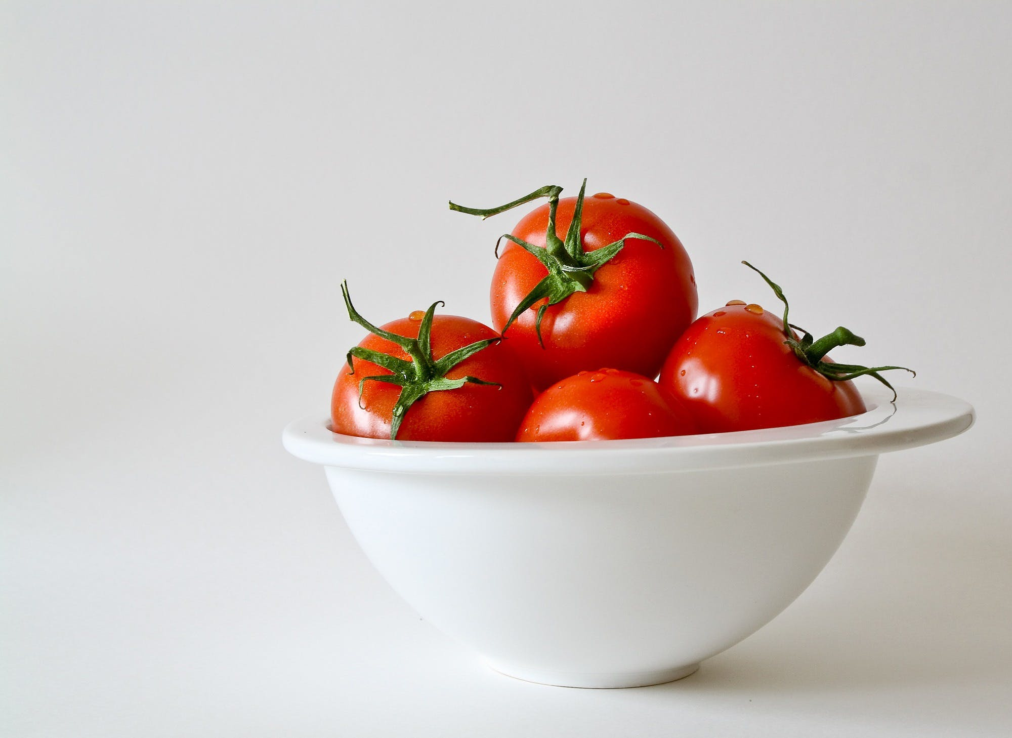 Red Tomatoes in White Bowl