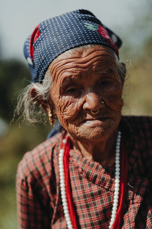 Elderly Indian woman in beads on street