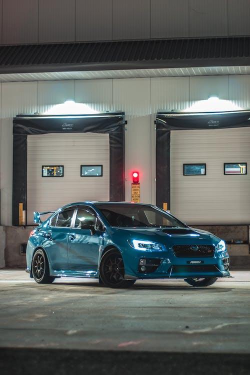Blue Bmw M 3 Coupe Parked Near Building