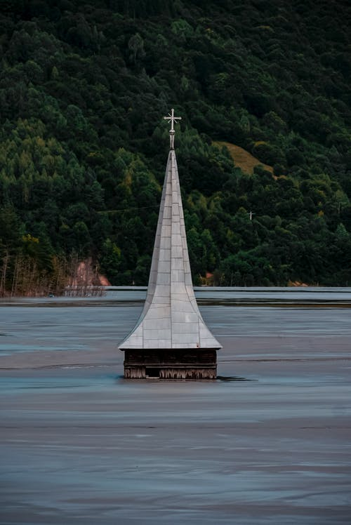 Lonely church under water in mountain valley