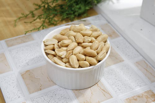Peanuts in White Ceramic Bowl